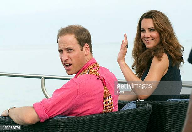 Prince William Duke of Cambridge and Catherine Duchess of Cambridge arrive in Honiara on their way to Tivanipupu on day 7 of their Diamond Jubilee...