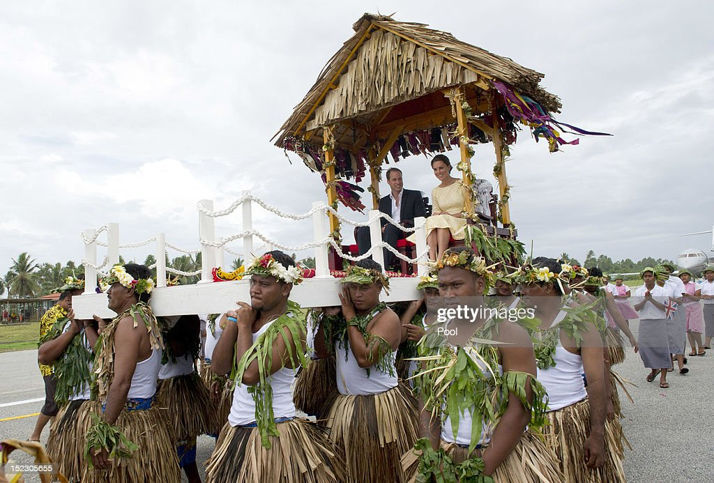 Prince William, Duke of Cambridge and Catherine, Duchess of Cambridge are carried from their plane to a welcoming ceremony on September 18, 2012 in Tuvalu. Prince William, Duke of Cambridge and Catherine, Duchess of Cambridge are on a Diamond Jubilee tour representing the Queen taking in Singapore, Malaysia, the Solomon Islands and Tuvalu.
