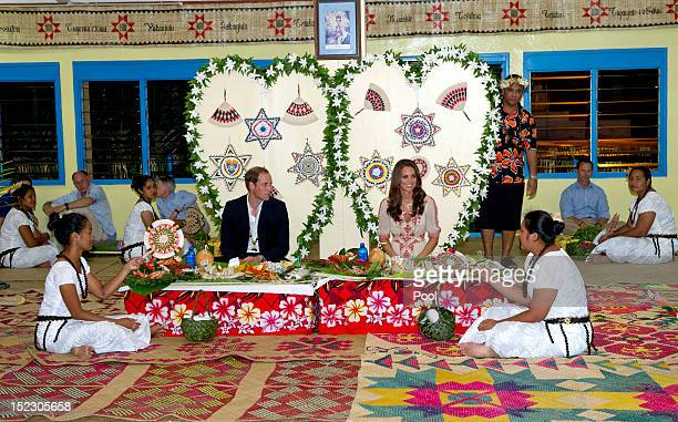 Prince William Duke of Cambridge and Catherine Duchess of Cambridge have a traditional dinner at Tausoa Lima Falekaupule on September 18 2012 in...