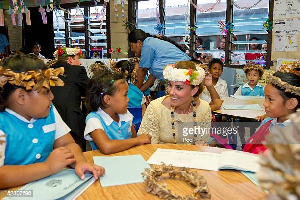 Prince William, Duke of Cambridge and Catherine, Duchess of Cambridge visit Nauti Primary School on September 18, 2012 in Tuvalu. Prince William,...