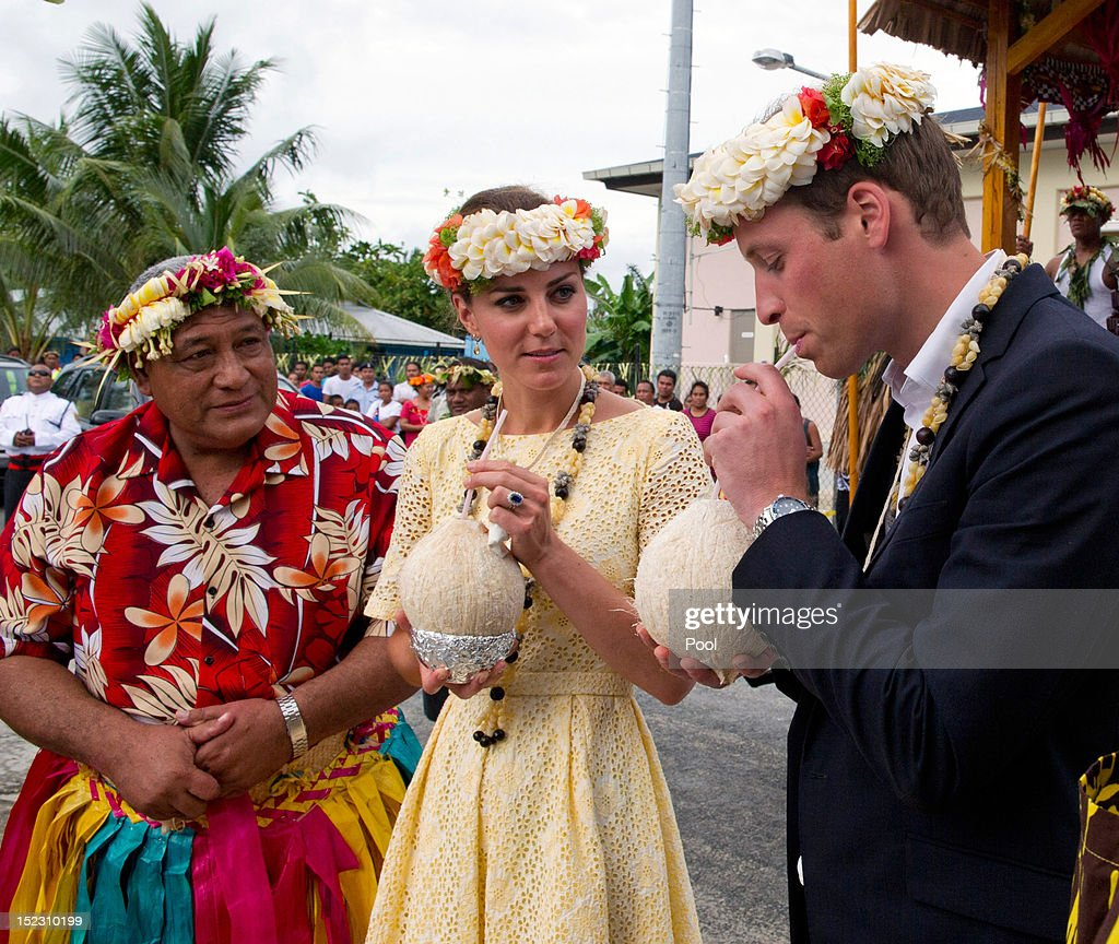 Prince William, Duke of Cambridge and Catherine, Duchess of Cambridge drink coconut milk from a tree planted by the Queen in 1982 on September 18, 2012 in Tuvalu. Prince William, Duke of Cambridge and Catherine, Duchess of Cambridge are on a Diamond Jubilee tour representing the Queen taking in Singapore, Malaysia, the Solomon Islands and Tuvalu.