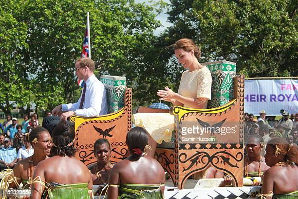 Prince William Duke of Cambridge and Catherine Duchess of Cambridge are carried from the boat from the dock to the plane in Marau on day 8 of their...