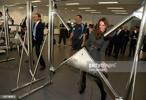 Prince William Duke of Cambridge and Catherine Duchess of Cambridge play a reaction game in the new gym during the official launch of The Football...