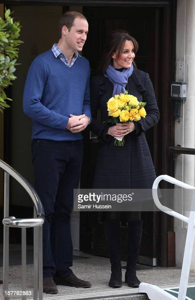 Prince William Duke of Cambridge and Catherine Duchess of Cambridge leave the King Edward VII Hospital after she was treated for acute morning...