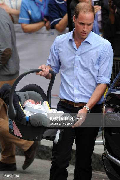 Prince William Duke of Cambridge and Catherine Duchess of Cambridge depart The Lindo Wing with their newborn son at St Mary's Hospital on July 23,...