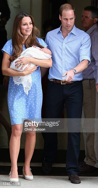 Prince William Duke of Cambridge and Catherine Duchess of Cambridge depart The Lindo Wing with their newborn son Prince George of Cambridge at St...