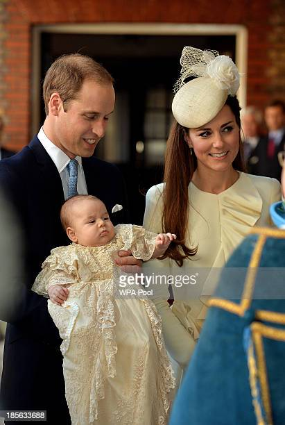 Prince William Duke of Cambridge and Catherine Duchess of Cambridge arrive holding their son Prince George at Chapel Royal in St James's Palace ahead...