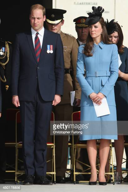 Prince William Duke of Cambridge and Catherine Duchess of Cambridge stand watch DDay veterans march past as they attend the 70th anniversary of the...