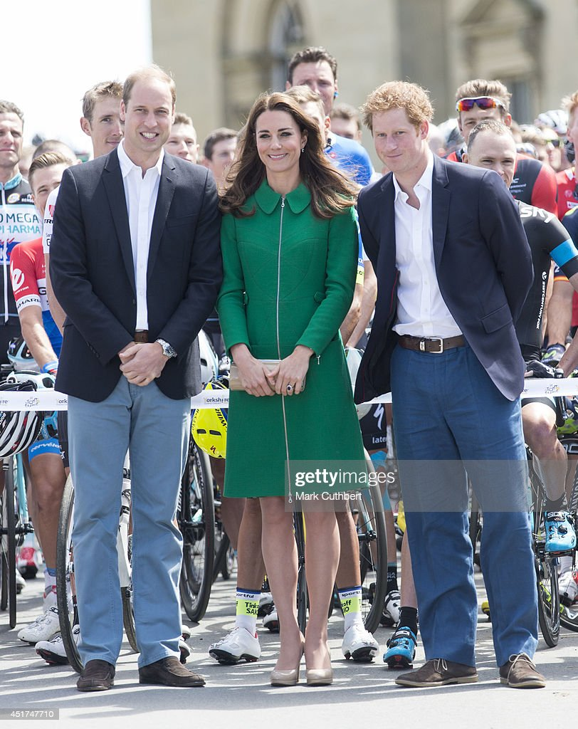 Prince William, Duke of Cambridge and Catherine, Duchess of Cambridge with Prince Harry attend the Grand Depart of The Tour de France at Harewood House on July 5, 2014 in Leeds, England.