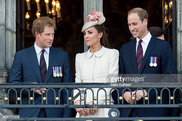 Prince William Duke of Cambridge and Catherine Duchess of Cambridge with Prince Harry on the balcony of the Town Hall in Mons during a day of World...