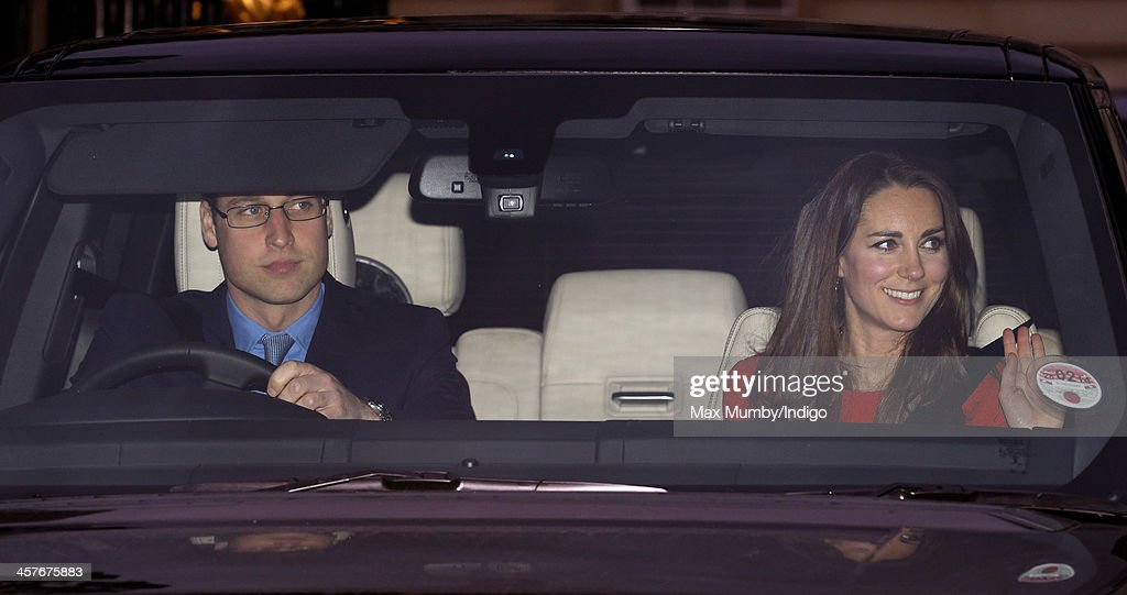 Prince William, Duke of Cambridge and Catherine, Duchess of Cambridge leave Buckingham Palace after attending a Christmas Lunch hosted by Queen Elizabeth II on December 18, 2013 in London, England.