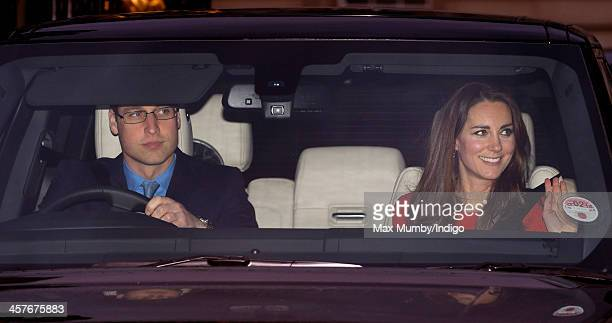 Prince William, Duke of Cambridge and Catherine, Duchess of Cambridge leave Buckingham Palace after attending a Christmas Lunch hosted by Queen...