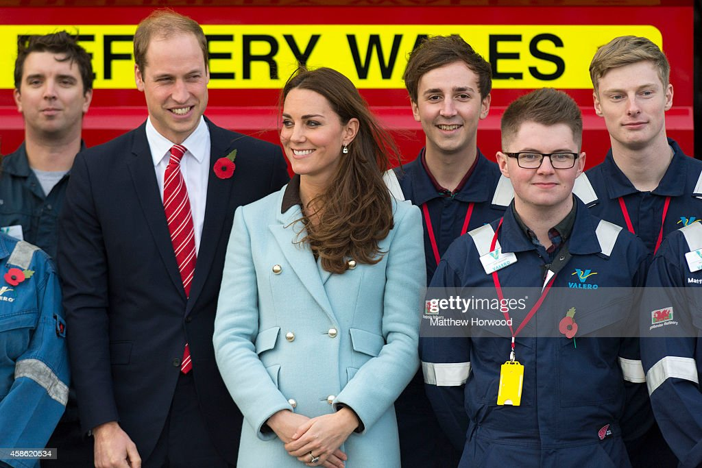 Prince William, Duke of Cambridge and Catherine, Duchess of Cambridge pose with workers as they visit Pembroke Refinery on November 8, 2014 in Pembroke, Wales.