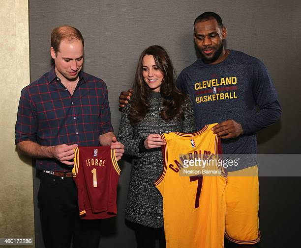 Prince William Duke of Cambridge and Catherine Duchess of Cambridge pose with LeBron James as they attend the Cleveland Cavaliers vs Brooklyn Nets...