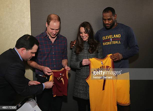 Prince William Duke of Cambridge and Catherine Duchess of Cambridge pose with LeBron James backstage as they attend the Cleveland Cavaliers vs...