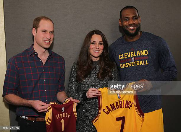 Prince William Duke of Cambridge and Catherine Duchess of Cambridge pose with basketball player LeBron James backstage as they attend the Cleveland...
