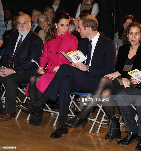 Prince William Duke of Cambridge and Catherine Duchess of Cambridge wait for the start of a performance during their visit to The Door on December 9...