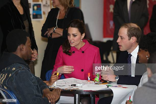 Prince William Duke of Cambridge and Catherine Duchess of Cambridge speak to people involved with CityKids during their visit to The Door on December...