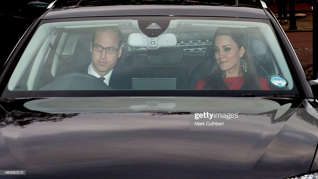 Prince William, Duke of Cambridge and Catherine, Duchess of Cambridge attend a Christmas Lunch at Buckingham Palace on December 17, 2014 in London, England.