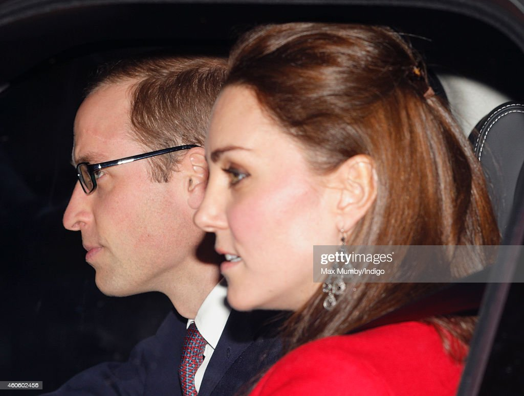 Prince William, Duke of Cambridge and Catherine, Duchess of Cambridge attend a Christmas lunch for members of the Royal Family hosted by Queen Elizabeth II at Buckingham Palace on December 17, 2014 in London, England.