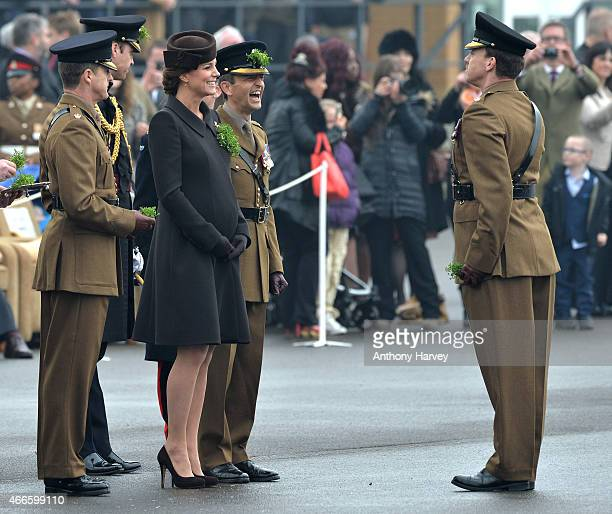 Prince William Duke of Cambridge and Catherine Duchess of Cambridge attend the St Patrick's Day Parade at Mons Barracks on March 17 2015 in Aldershot...
