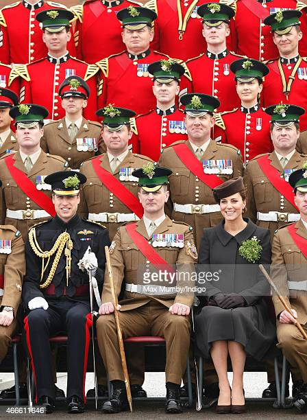 Prince William Duke of Cambridge and Catherine Duchess of Cambridge pose for a regimental photograph as they attend the annual St Patrick's Day...