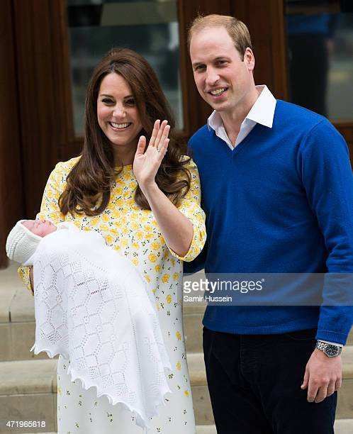 Prince William Duke of Cambridge and Catherine Duchess of Cambridge depart the Lindo Wing with their new baby at St Mary's Hospital on May 2 2015 in...