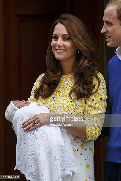 Prince William Duke of Cambridge and Catherine Duchess of Cambridge posing to media outside The Lindo Wing with their newborn girl at St Mary's...