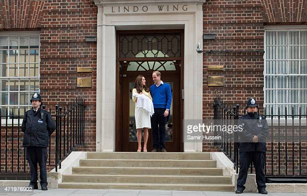 Prince William Duke of Cambridge and Catherine Duchess of Cambridge depart the Lindo Wing with their newborn baby at St Mary's Hospital on May 2 2015...