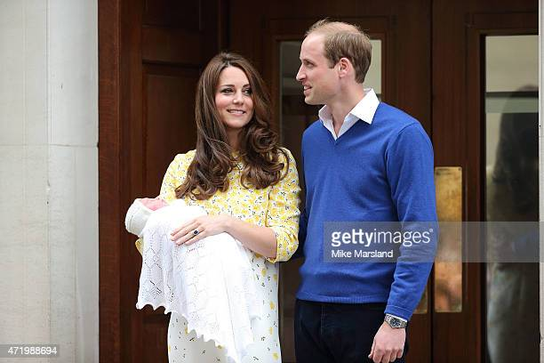 Prince William, Duke of Cambridge and Catherine, Duchess Of Cambridge depart the Lindo Wing with their new baby daughter at St Mary's Hospital on May...