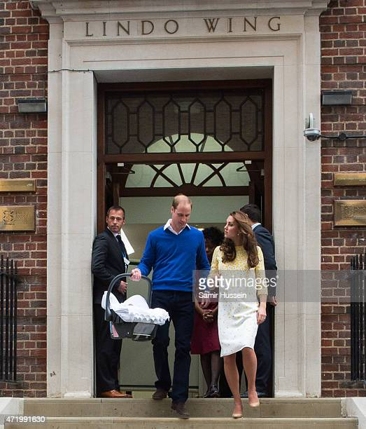 Prince William Duke of Cambridge and Catherine Duchess of Cambridge depart the Lindo Wing with their newborn baby daughter at St Mary's Hospital on...