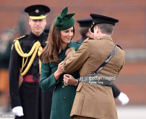 Prince William Duke of Cambridge and Catherine Duchess of Cambridge attend the St Patrick's Day parade at Mons Barracks on March 17 2014 in Aldershot...