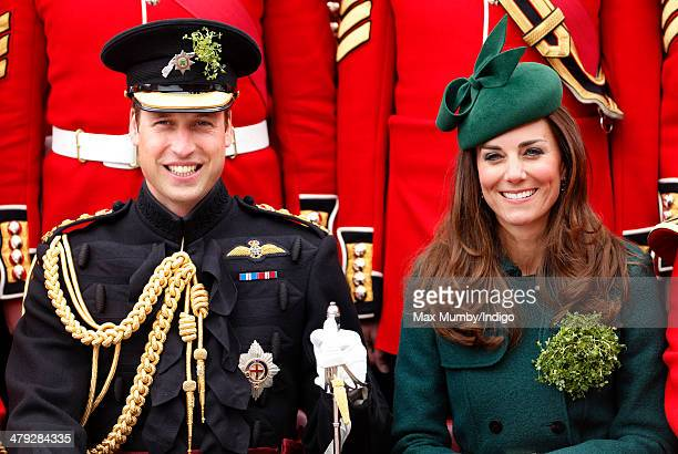 Prince William Duke of Cambridge and Catherine Duchess of Cambridge pose for a group photograph with soldiers of the Irish Guards as they attend the...