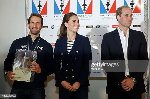 Prince William Duke of Cambridge and Catherine Duchess of Cambridge pose with Sir Ben Ainslie skipper of Britain's Land Roverbacked BAR team after...