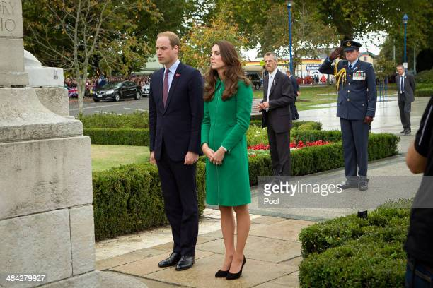 Prince William Duke of Cambridge and Catherine Duchess of Cambridge place a flower on the War Memorial at the Cambridge Town Hall on April 12 2014 in...