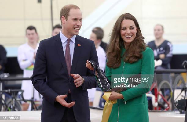 Prince William Duke of Cambridge and Catherine Duchess of Cambridge receive a cycling jersey for Prince George at the opening of new National Cycling...
