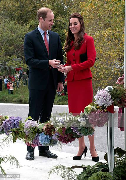 Prince William Duke of Cambridge and Catherine Duchess of Cambridge cut the ribbon at a ceremony to open the new visitors centre at the Christchurch...