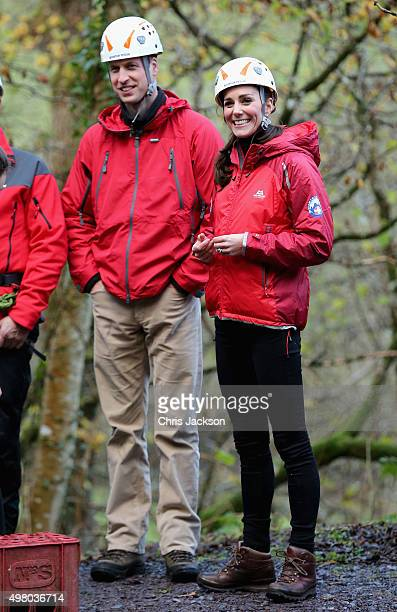 Prince William Duke of Cambridge and Catherine Duchess of Cambridge watch children on a zipwire as they visit the Towers Residential Outdoor...