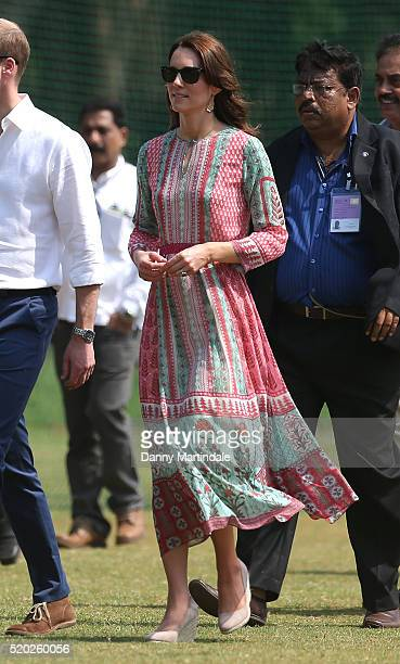 Prince William, Duke of Cambridge and Catherine, Duchess of Cambridge play cricket during a visit to meet children from Magic Bus, Childline and...