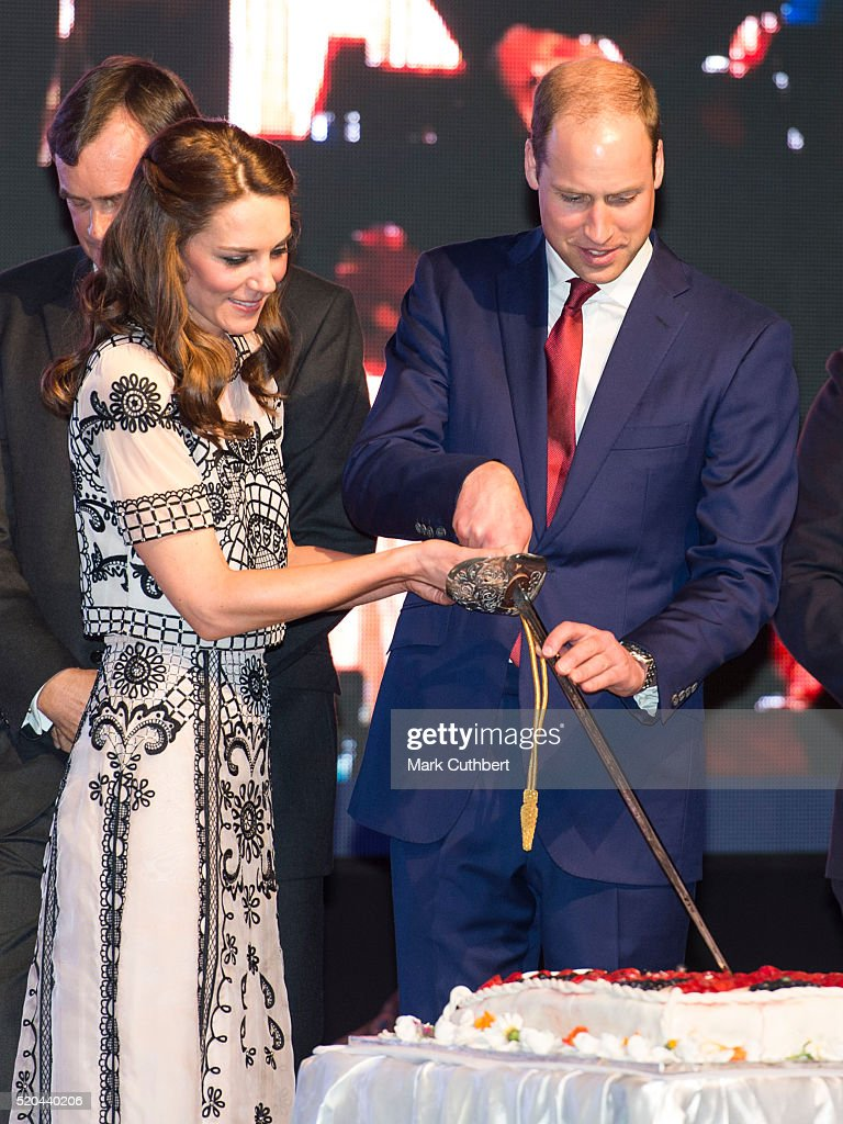 Prince William, Duke of Cambridge and Catherine, Duchess of Cambridge cut a birthday cake for Queen Elizabeth II at a Garden party celebrating the Queen's 90th birthday on April 11, 2016 in New Delhi, India.