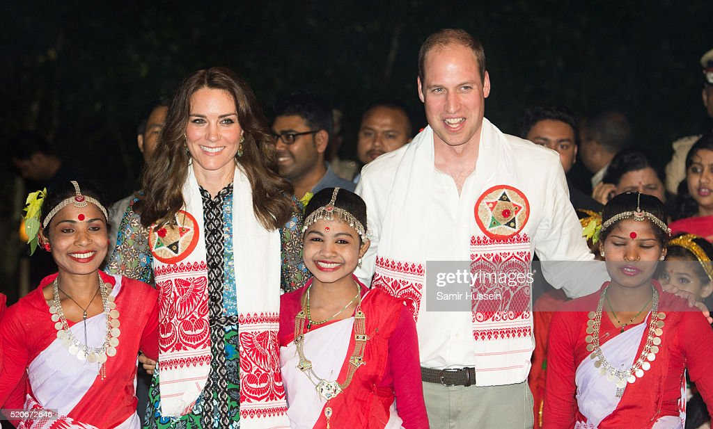 Prince William, Duke of Cambridge and Catherine, Duchess of Cambridge pose with dancers during a Bihu Festival Celebration at Diphlu River Lodge atKaziranga National Park on April 12, 2016 in Guwahati, India.