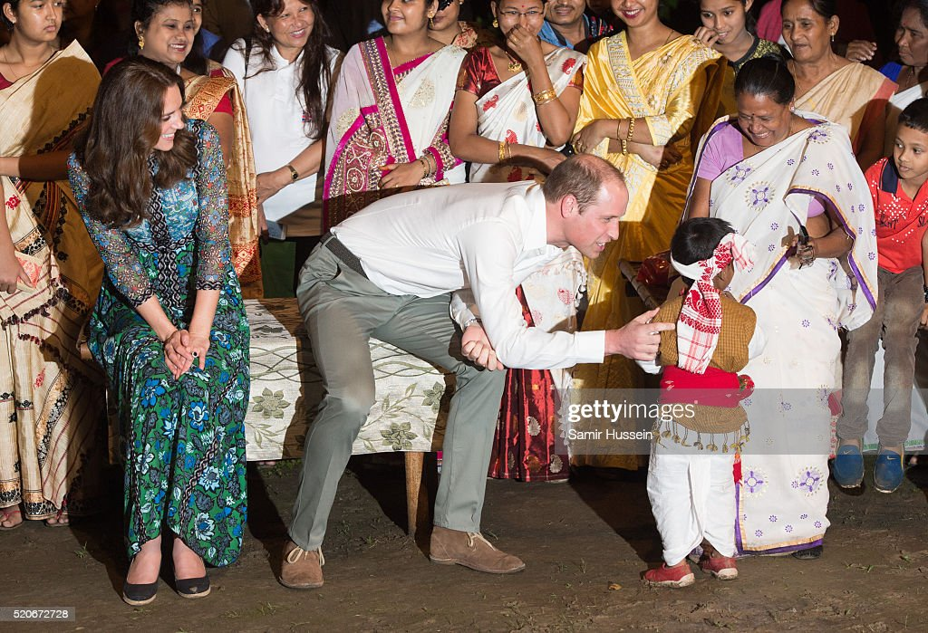 Prince William, Duke of Cambridge and Catherine, Duchess of Cambridge watch a boy dance during a Bihu Festival Celebration at Diphlu River Lodge atKaziranga National Park on April 12, 2016 in Guwahati, India.