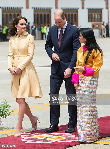 Prince William, Duke of Cambridge and Catherine, Duchess of Cambridge walk with Queen Jetsun Pema of Bhutan as they arrive at Paro International...