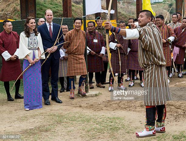 Prince William Duke of Cambridge and Catherine Duchess of Cambridge watch archery at Thimphu's openair archery venue on April 14 2016 in Thimphu...
