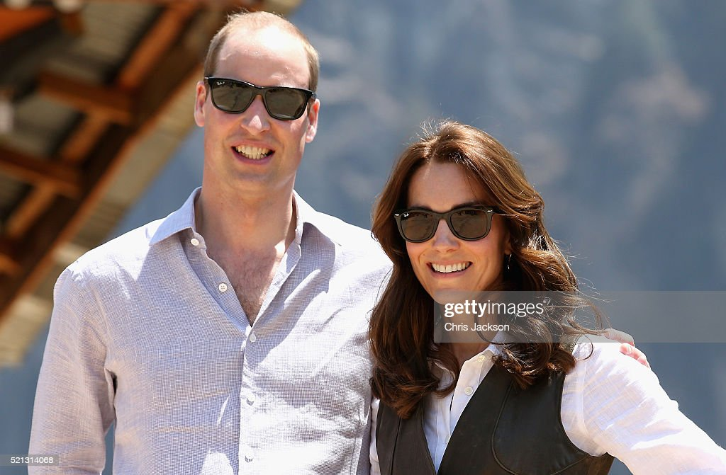Prince William, Duke of Cambridge and Catherine, Duchess of Cambridge pose next to a prayer wheel on the trek up to Tiger's Nest during a visit to Bhutan on the 15th April 2016 in Thimphu, Bhutan. The Royal couple are visiting Bhutan as part of a week long visit to India and Bhutan that has taken in cities such as Mumbai, Delhi, Kaziranga, Bhutan and Agra.