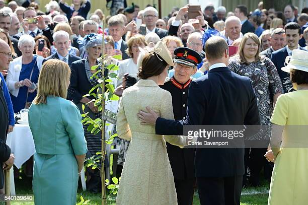 Prince William Duke of Cambridge and Catherine Duchess of Cambridge attend the Secretary of state for Northern ireland's Garden Party at Hillsborough...