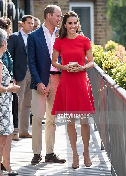 Prince William Duke of Cambridge and Catherine Duchess of Cambridge arrive to visit a helpline service run by one of the eight charity partners of...