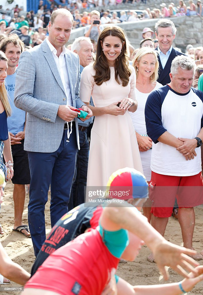 Prince William, Duke of Cambridge and Catherine, Duchess of Cambridge watch a demonstration as they visit The Wave Project on Towan Beach on September 1, 2016 in Newquay, England.
