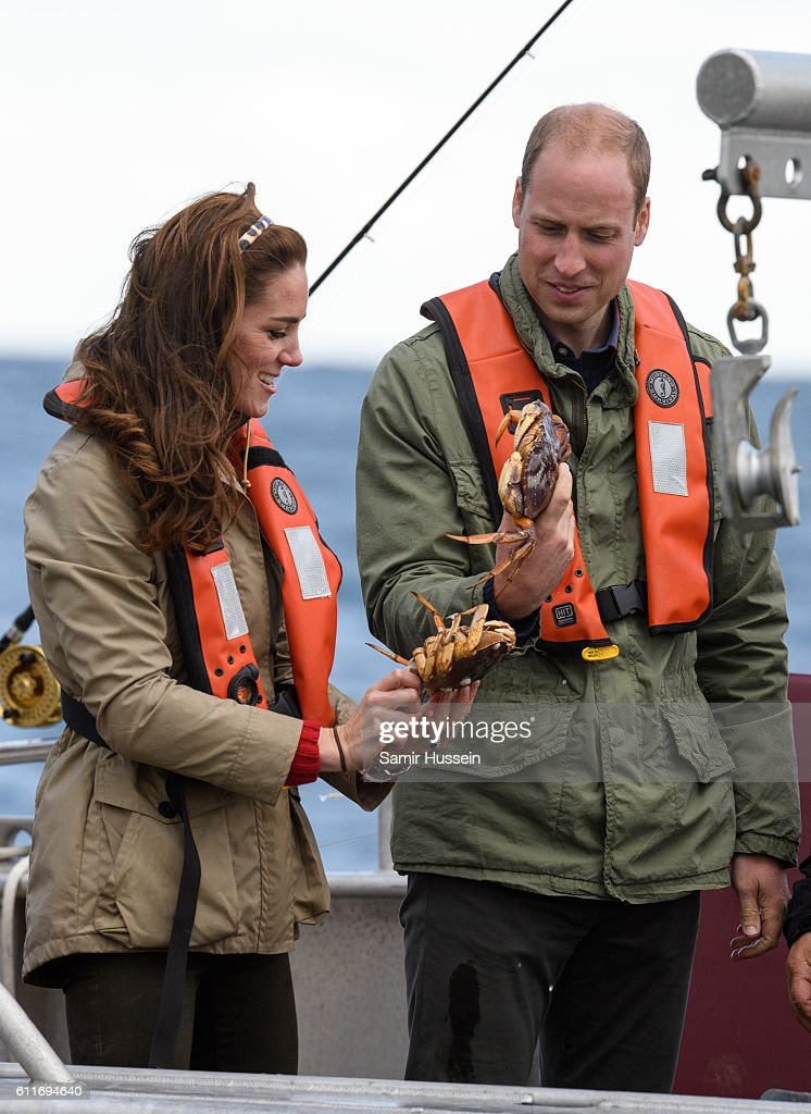 Prince William, Duke of Cambridge and Catherine, Duchess of Cambridge hold a grab on a fishing boat trip on September 30, 2016 in Haida Gwaii, Canada.