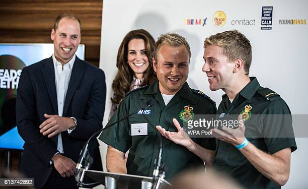 Prince William Duke of Cambridge and Catherine Duchess of Cambridge listen to ambulance man Dan Farnworth and Rich Morton of how they helped each...
